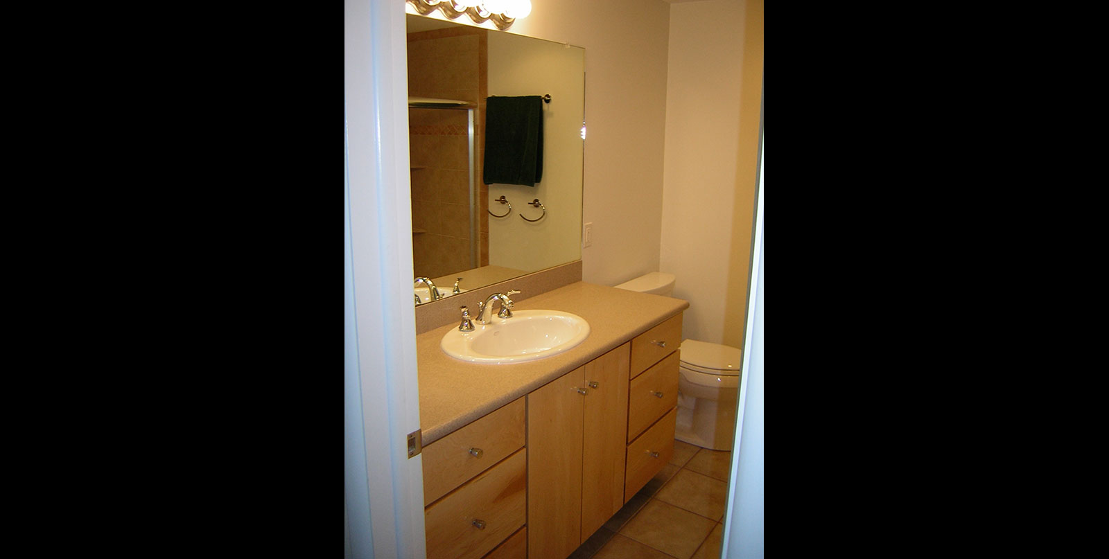 Covenant Construction Group - Bathroom Remodel, Half Bathroom with Mirror and Custom Cabinets - Ann Arbor, MI