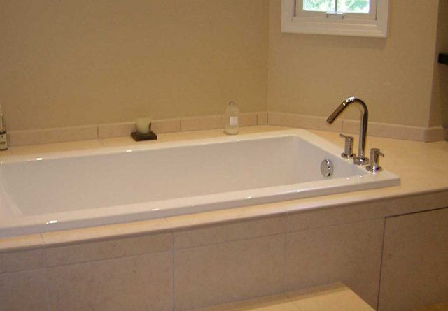 Covenant Construction Group - Bathroom Remodel, Deep Tub with Custom Tile - Ann Arbor, MI