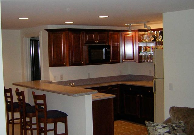 Covenant Construction Group - Basement Remodel, Kitchenette and Bar with Custom Cabinets, Bar Stool Seating - Dexter, MI